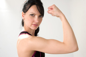 Woman flexing biceps.