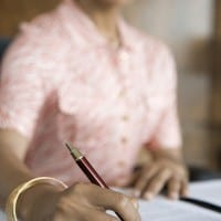 Women pink writing at desk